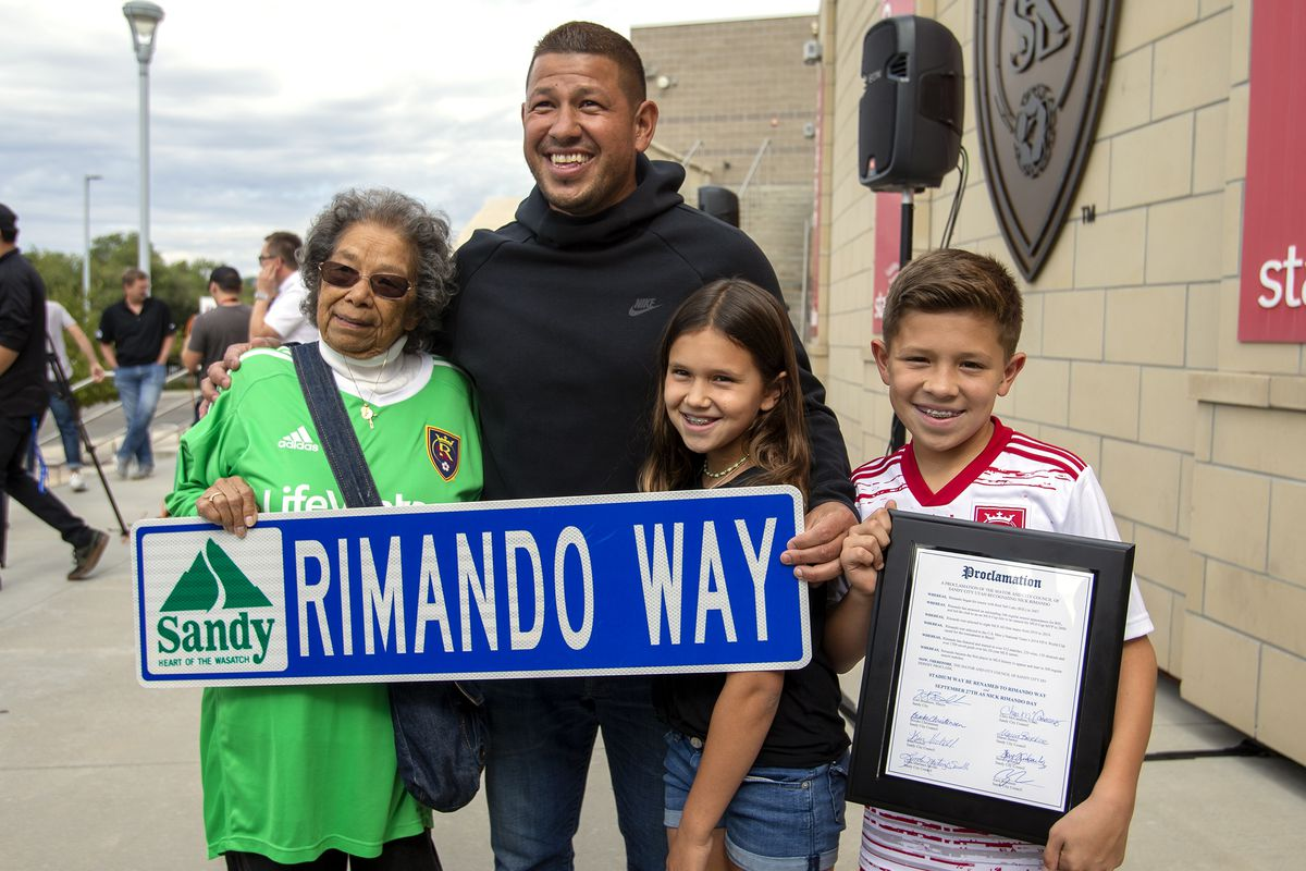 Grace Almendarez, godmother to Real Salt Lake's goalkeeper Nick Rimando, stands with him and his kids Benny Rose Rimando and Jett Nicholas Rimando at Rio Tinto Stadium in Sandy on Friday, Sept. 27, 2019. A street was renamed Rimando Way. Rimando will play his last home game on Sunday.
