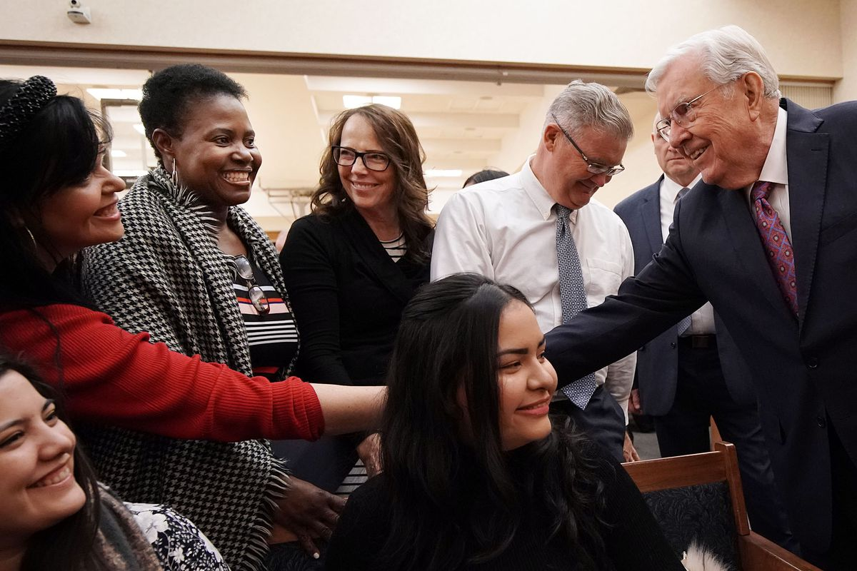 President M. Russell Ballard, acting president of the Quorum of the Twelve Apostles of The Church of Jesus Christ of Latter-day Saints, shakes hands with some of those in attendance as he arrives for a devotional with young and mid-single adults and young married couples in New York City on Saturday, Nov. 16, 2019.