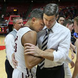 Lone Peak's Frank Jackson is hugged by coach David Evans after the Duke recruit scored 38 points in a losing effort as  Copper Hills High School  defeats Lone Peak  High School 74-59 in the 5A State Boys Basketball State Tournament quarterfinals Thursday, March 3, 2016, in Salt Lake City.