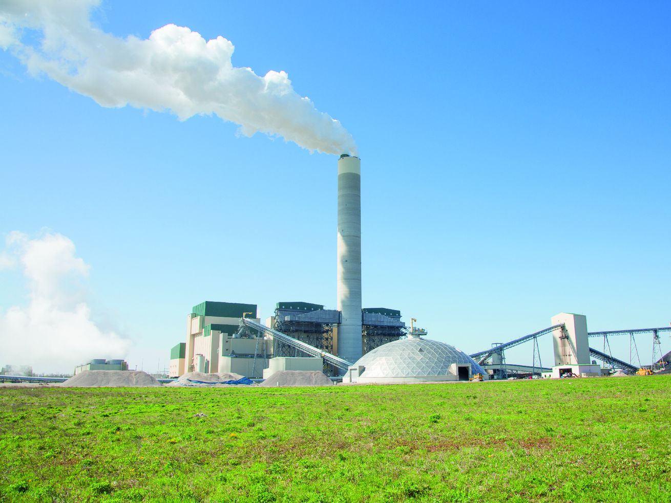 The Prairie State coal plant would shut down under a proposal being considered in Springfield that environmental groups support. But municipalities, including some in the Chicago area, that have long-term deals to buy electricity from Prairie State could end up being hit with higher prices even as they're still on the hook to pay off bonds they issued to buy in to the plant.
