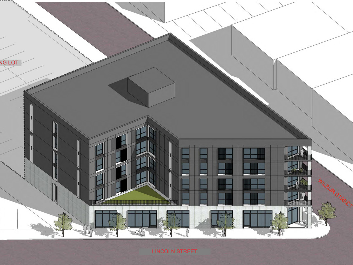 Rendering of a triangular-shaped four-story building which is part of NW Goldberg Developments in Detroit.