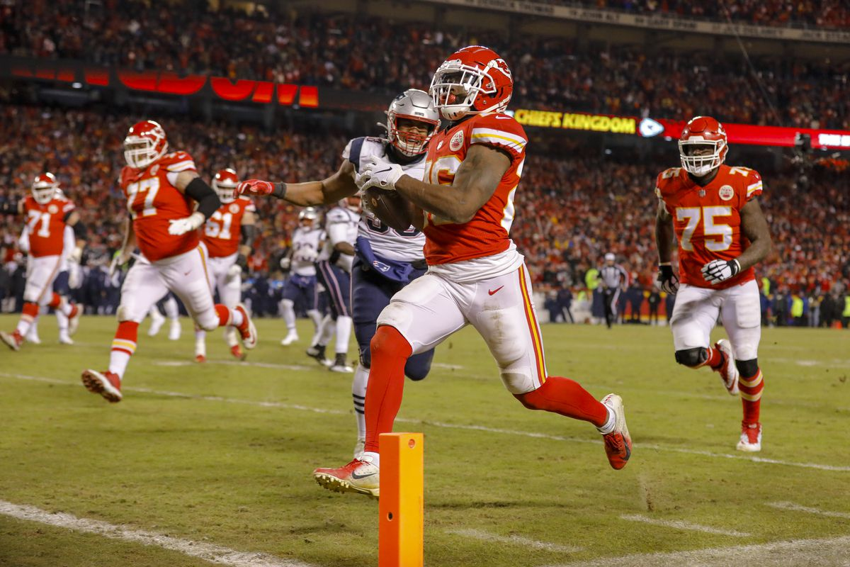 Kansas City Chiefs running back Damien Williams runs into the end zone on a 23-yard touchdown catch in the fourth quarter against the New England Patriots in the AFC Championship Game at Arrowhead Stadium on January 20, 2019 in Kansas City, Missouri.