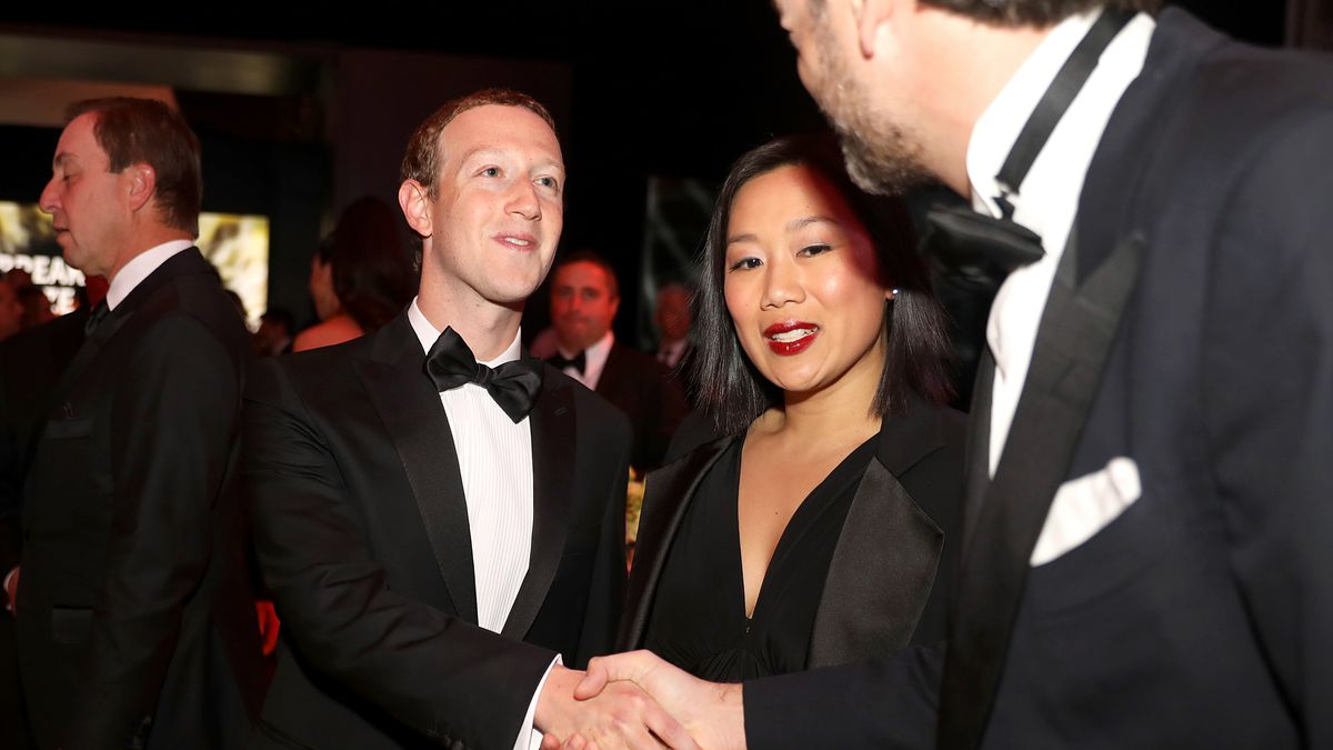 Mark Zuckerberg and Priscilla Chan shake hands at a black-tie event.