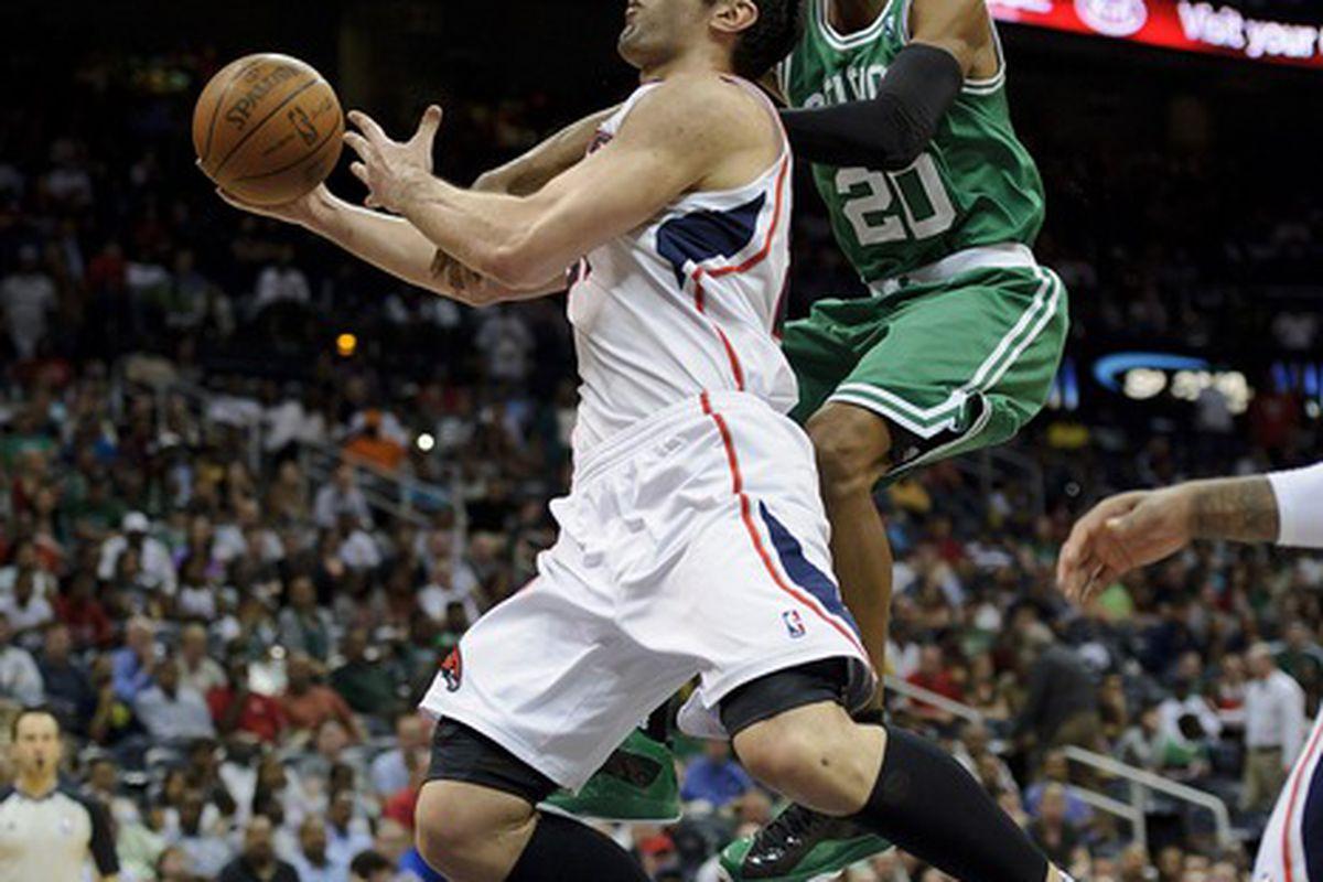 Mar 19, 2012; Atlanta, GA, USA; Atlanta Hawks center Zaza Pachulia (27) is fouled by Boston Celtics shooting guard Ray Allen (20) as he shoots during the second half at Philips Arena. Boston won 79-76. Mandatory Credit: Paul Abell-US PRESSWIRE