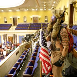 A protester yells inside the Senate Chamber on January 06, 2021 in Washington, DC. Congress held a joint session today to ratify President-elect Joe Biden's 306-232 Electoral College win over President Donald Trump. Pro-Trump protesters entered the U.S. Capitol building during mass demonstrations in the nation's capital.