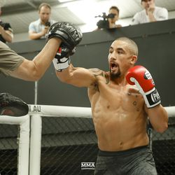 Robert Whittaker shows off his striking at UFC 234 media workout.