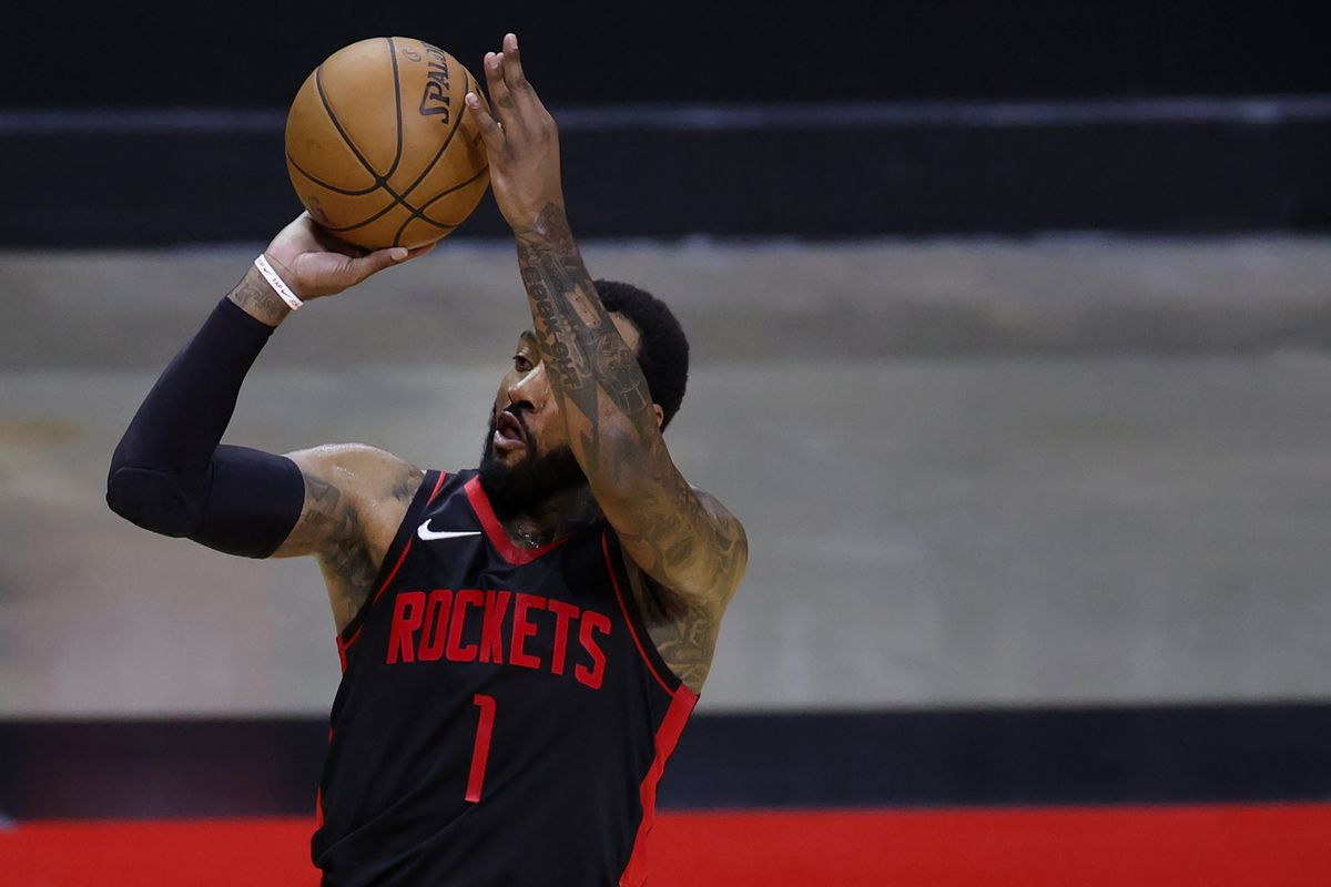 John Wall of the Houston Rockets shoots a three point basket during the third quarter against the Los Angeles Clippers at Toyota Center on April 23, 2021 in Houston, Texas.