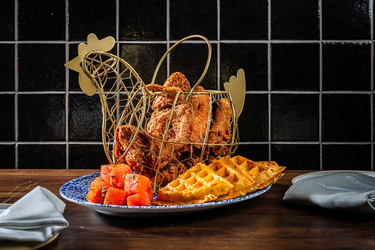 Yardbird's crispy, thick-battered fried chicken with waffles and watermelon salad.