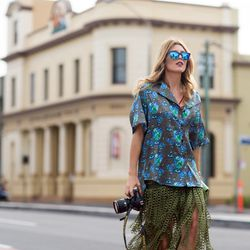 A printed collared shirt that matches polarized blue sunnies.