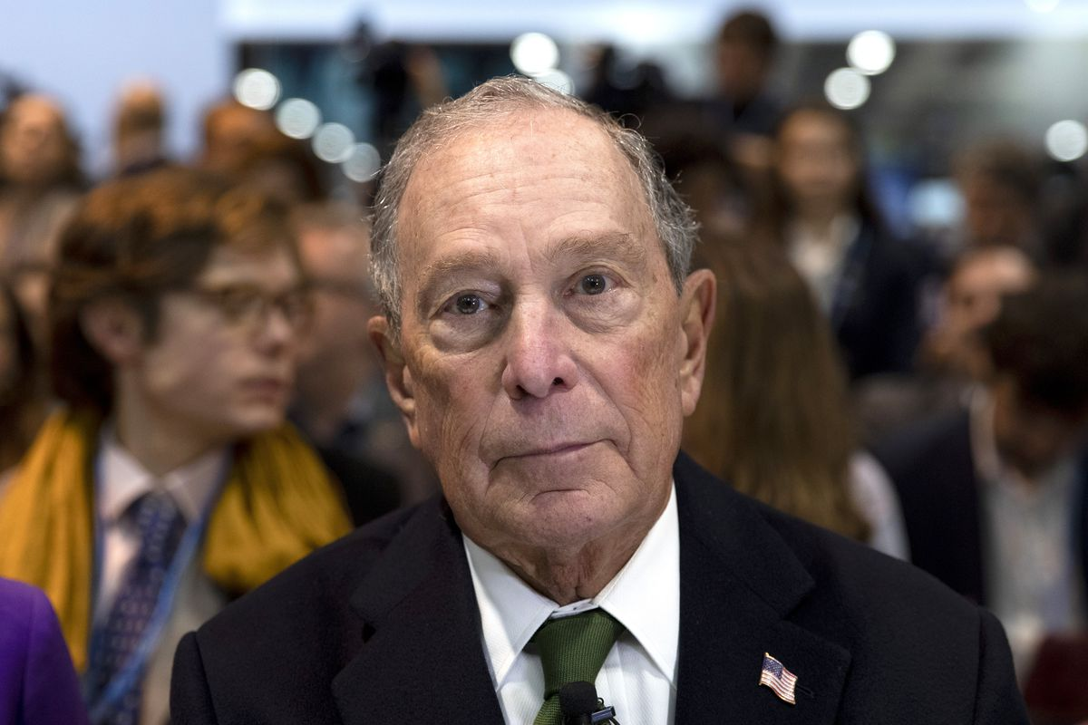 Michael Bloomberg looks at a camera.