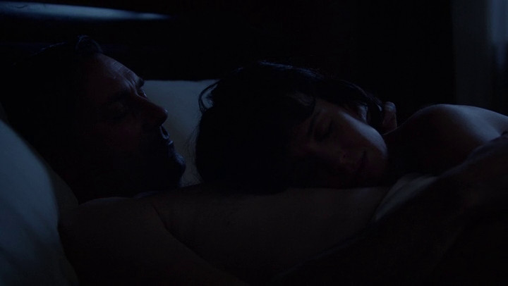 Diana and Don cuddle in bed on Mad Men.