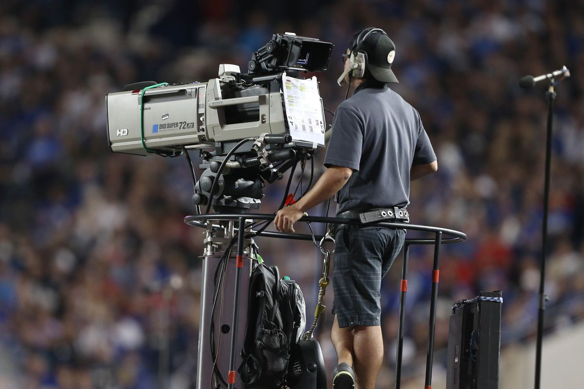 PROVO, UT - SEPTEMBER 21: A ESPN cameraman mans a camera during a game between the BYU Cougars and the Utah Utes at an NCAA football game September 21, 2013 at LaVell Edwards Stadium in Provo, Utah. Utah beat BYU 20-13. (Photo by George Frey/Getty Images)
