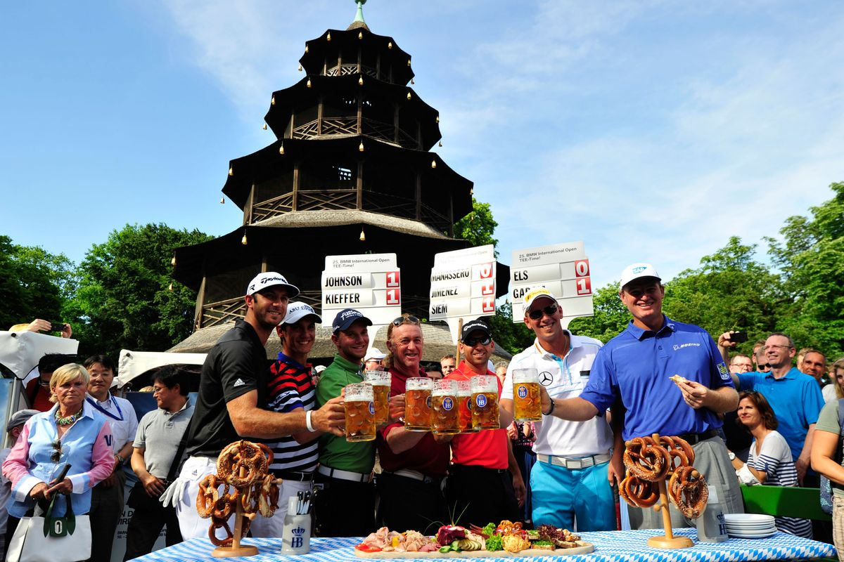 Dustin Johnson of the USA, Matteo Manassero of Italy, Maximilian Kieffer of Germany, Miguel Angel Jimenez of Spain, Sergio Garcia of Spain, Marcel Seim of Germany and Ernie Els of South Africa pose with beers during the BMW International Open