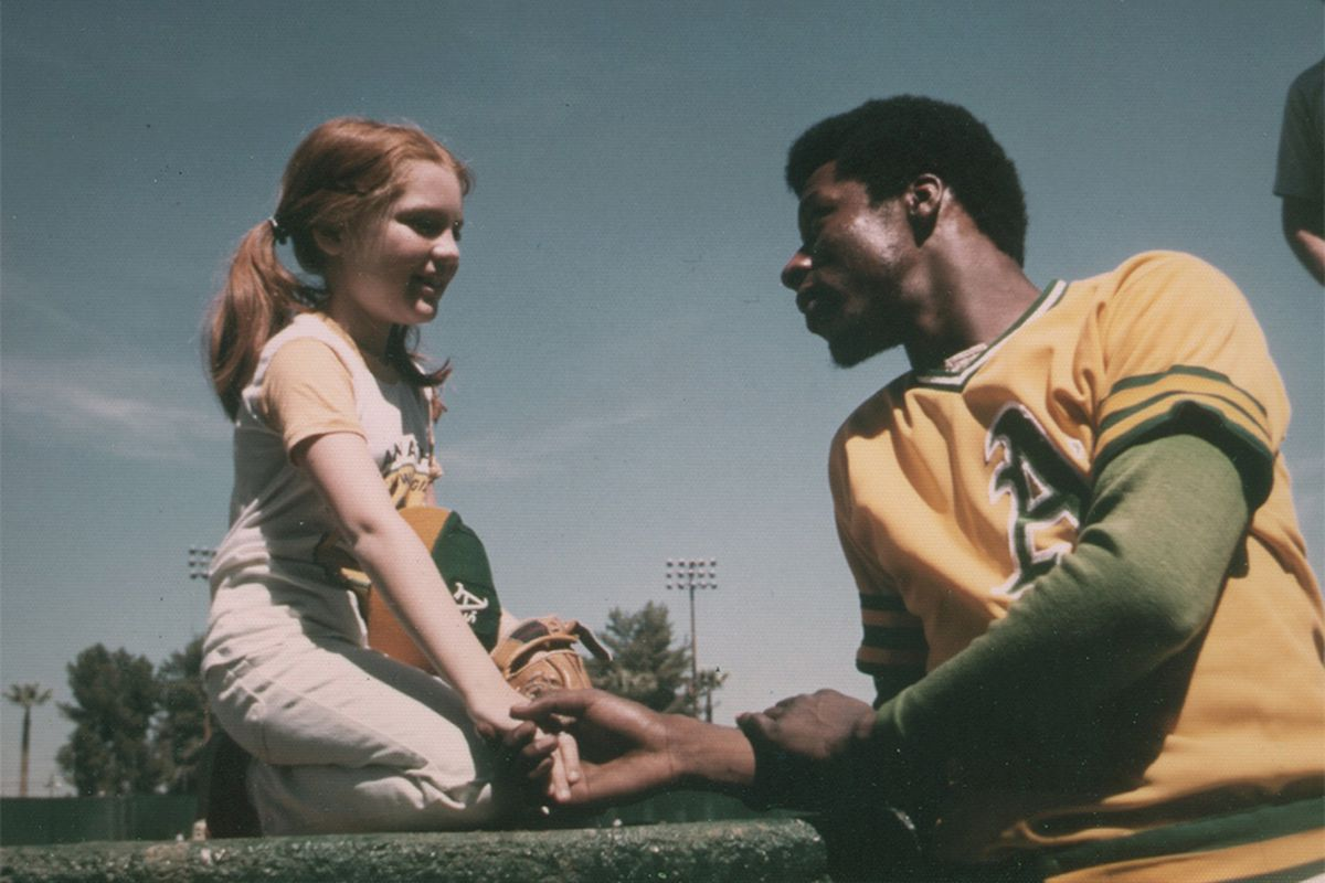 Young Anne Bergman sits with then-rookie Mike Norris.