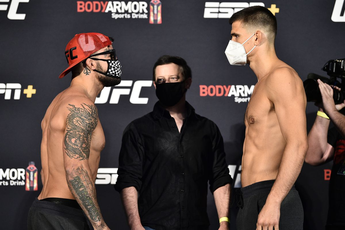 In this handout image provided by UFC, opponents Mike Perry and Mickey Gall face off during the UFC weigh-in at UFC APEX on June 26, 2020 in Las Vegas, Nevada.