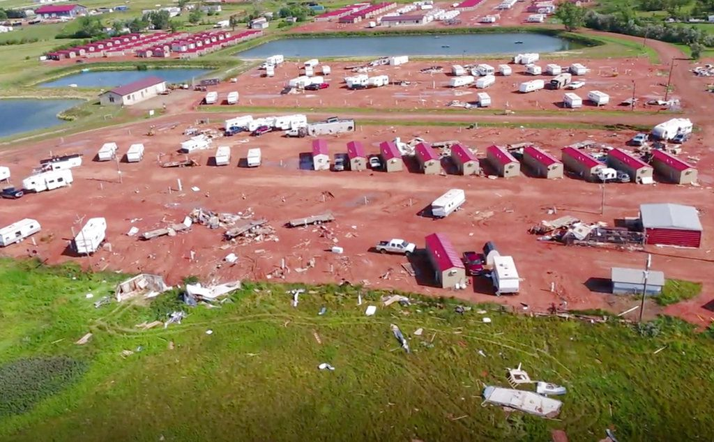 More than two dozen people were hurt in the storm that overturned recreational vehicles and tossed mobile homes, officials said Tuesday.   HRI Aerial Imaging via AP