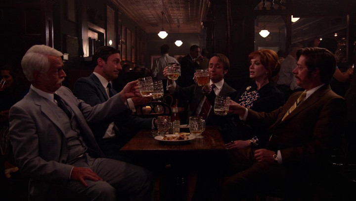 The characters toast Bert Cooper on Mad Men.