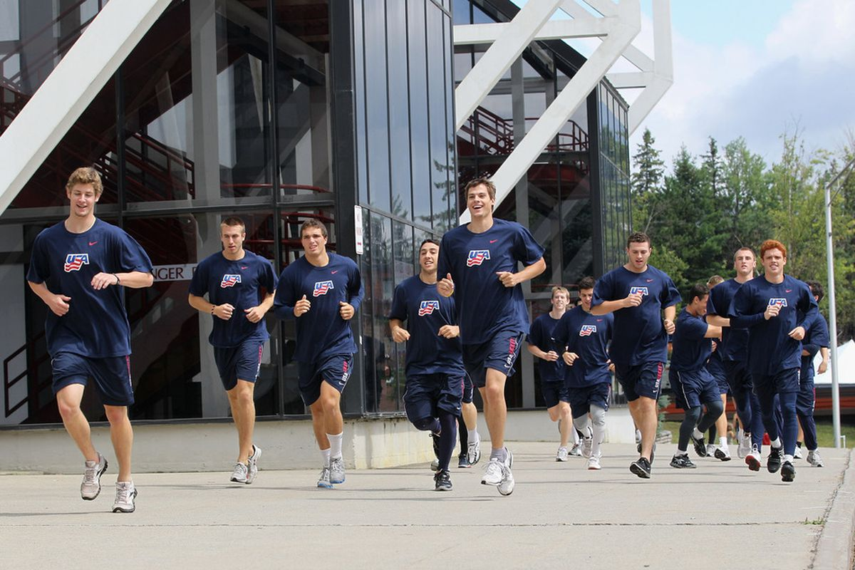 LAKE PLACID, NY - AUGUST 08: Team USA goes through dryland training prior to playing against Team Sweden at the Lake Placid Olympic Center on August 8, 2011 in Lake Placid, New York.  (Photo by Bruce Bennett/Getty Images)