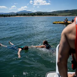 Rashelle Johnson, a firefighter paramedic from the Weber Fire District, swims toward David Francis, a firefighter pretending to be the victim of a boating accident, while training on water rescue skills at Pineview Reservoir near Huntsville, Weber County, on Monday, June 28, 2021.