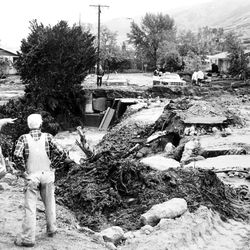Stone Creed ate through Eighth East in Bountiful, leaving area residents with a new canyon to survey. June 2, 1983.
