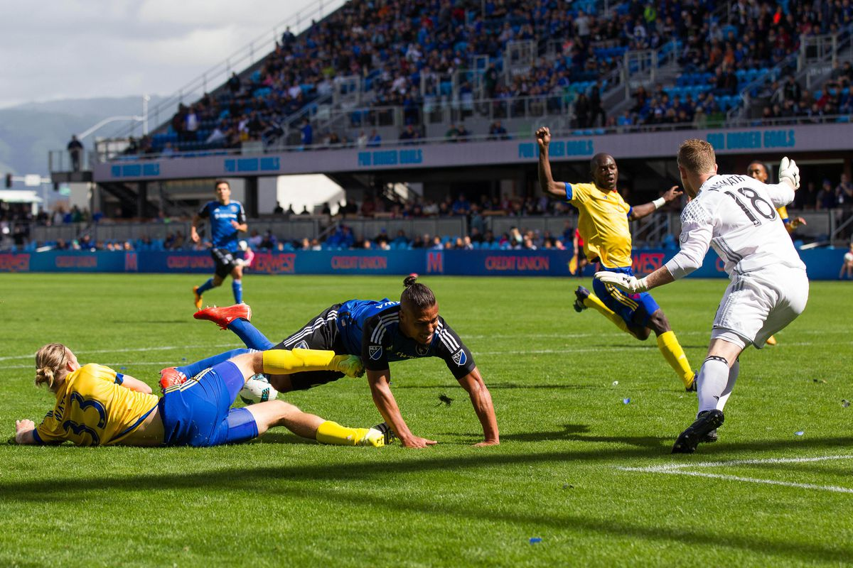 Jared Watts tackles Quincy Amarikwa in the box early in the first half to deny San Jose an opportunity.
