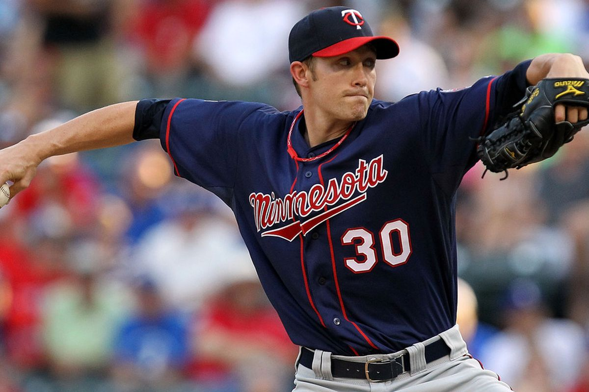 ARLINGTON, TX - JULY 28:  Scott Baker #30 of the Minnesota Twins throws against the Texas Rangers at Rangers Ballpark in Arlington on July 28, 2011 in Arlington, Texas.  (Photo by Ronald Martinez/Getty Images)