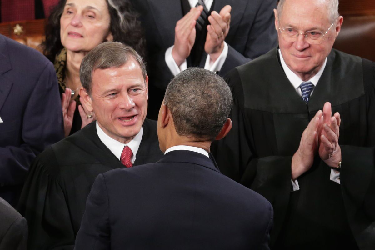 Chief Justice John Roberts greets President Obama at the State of the Union.