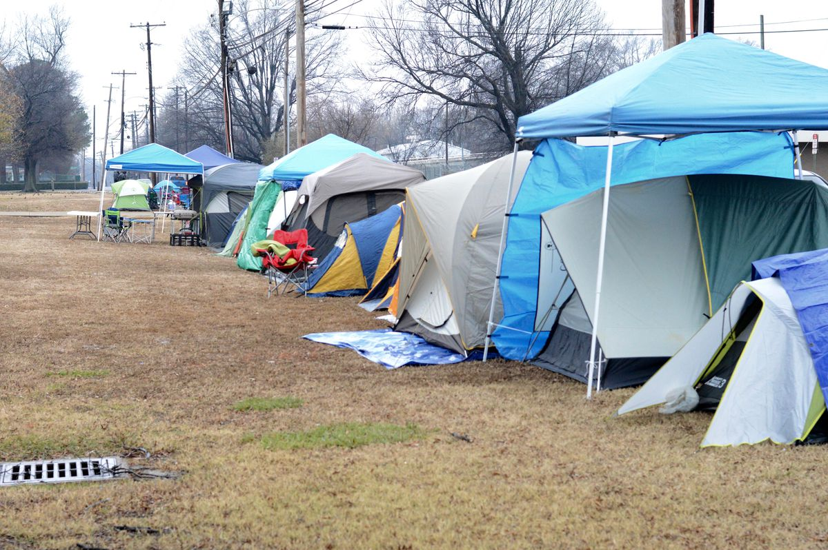 Tents line the grounds outside of Shelby County Schools' central office in 2016 in Memphis, where parents have camped out every January in recent years to apply for select optional schools. The application process moves completely online in 2018.