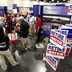 Delegates visit the FreedomWorks booth that tried to retire Orrin Hatch during the 2011 Republican State Convention Saturday, June 18, 2011 at South Towne Exposition Center.