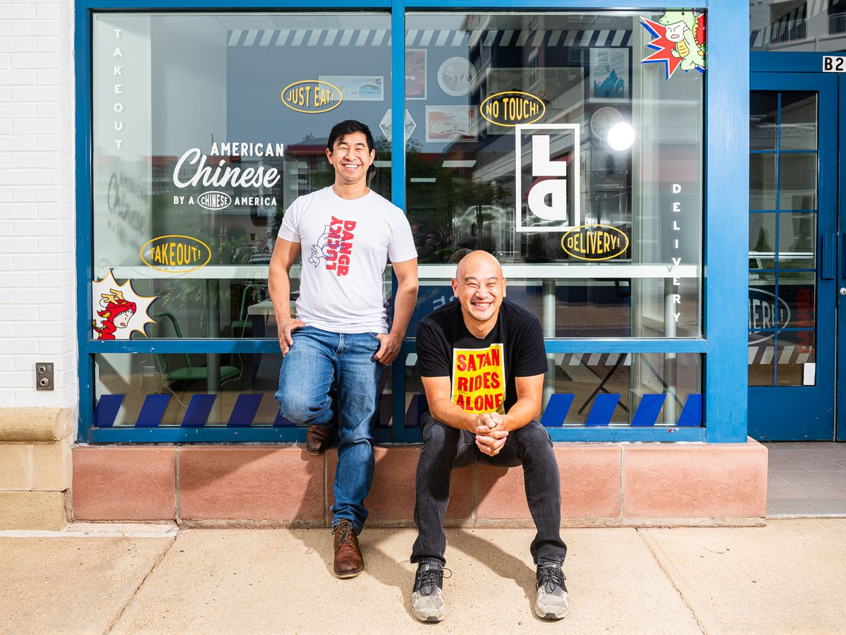 Lucky Danger founders Tim Ma, right, and Andrew Chiou pose in front of their new takeout storefront in Arlington, Virginia