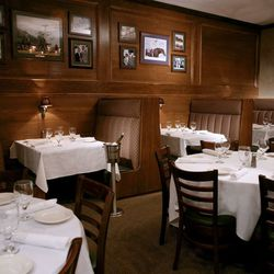 Many a big business deal has been made at the OG Bob's on Lemmon--or so we like to imagine. Dark wood paneling adorned with autographed photos of famous diners, white tablecloths and dim lighting set the scene in this masculine dining room where regulars