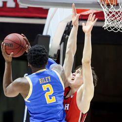 UCLA Bruins forward Cody Riley (2) goes for the basket against Utah Utes forward Mikael Jantunen (20) at the Jon M. Huntsman Center in Salt Lake City on Thursday, Feb. 20, 2020.