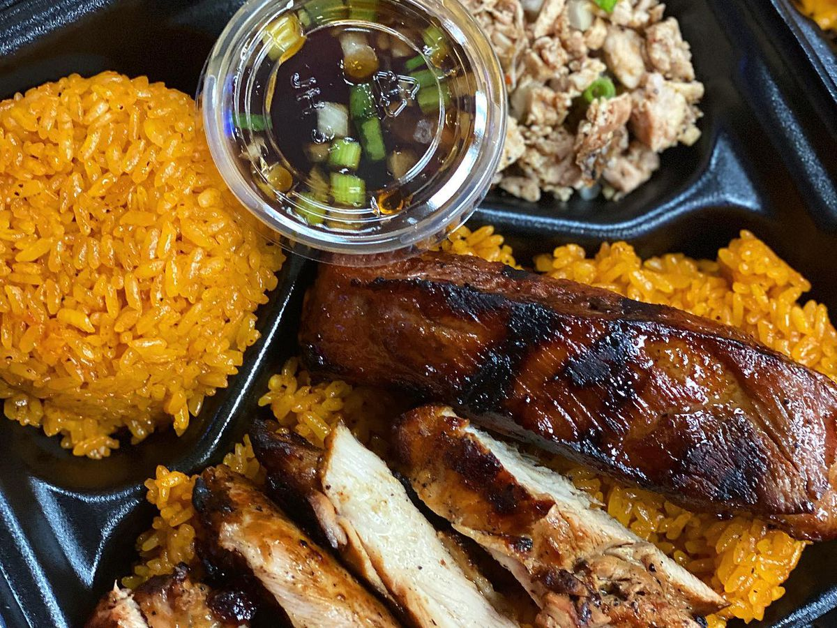 Chicken and red rice in a black container