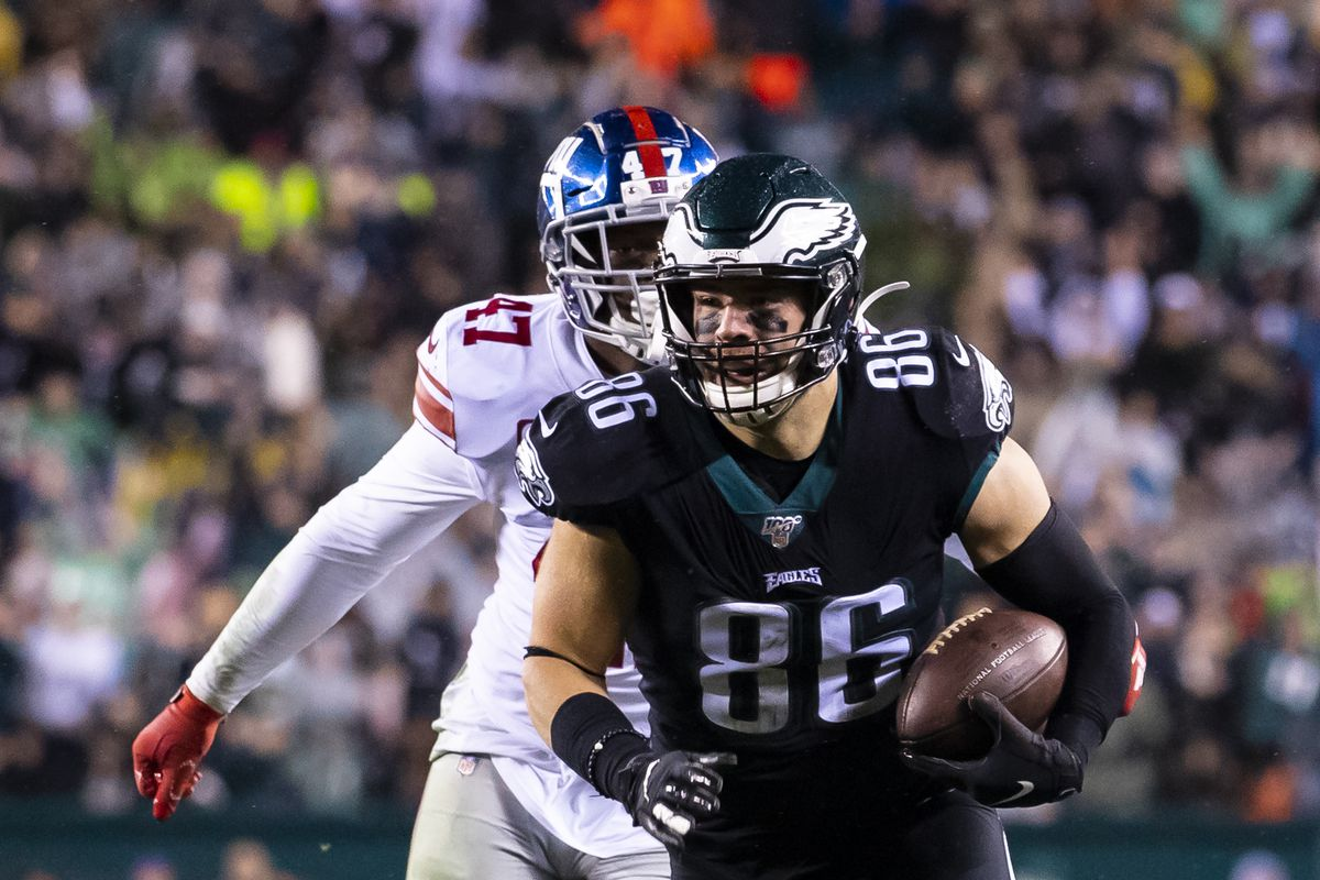 Zach Ertz of the Philadelphia Eagles runs with the ball as Alec Ogletree of the New York Giants pursues during the second quarter at Lincoln Financial Field on December 9, 2019 in Philadelphia, Pennsylvania.