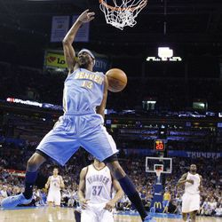 Denver Nuggets forward Corey Brewer dunks in front of Oklahoma City Thunder guard Derek Fisher (37) during the first quarter of an NBA basketball game in Oklahoma City, Wednesday, April 25, 2012.
