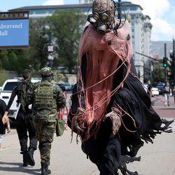 Comic Con attendees walk through downtown Salt Lake City on Saturday, Sept. 6, 2014.