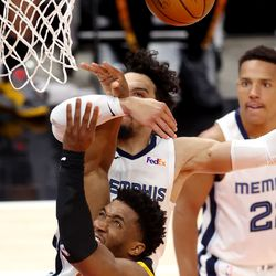 Utah Jazz guard Donovan Mitchell (45) is hit by Memphis Grizzlies forward Dillon Brooks (24) under the hoop as the Utah Jazz and the Memphis Grizzlies play in game 5 at Vivint Arena in Salt Lake City on Wednesday, June 2, 2021. Utah won 126-110, Utah advances to the second round.
