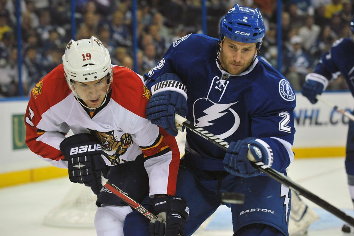 TAMPA, FL - OCTOBER 17:  Defenseman Eric Brewer #2 of the Tampa Bay Lightning battles left wing Scottie Upshall #19 of the Florida Panthers October 17, 2011 at St. Pete Times Forum in Tampa, Florida. (Photo by Al Messerschmidt/Getty Images)