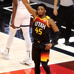 Utah Jazz guard Donovan Mitchell (45) lifts his arm into the air after being fouled on a drive to the hoop as the Utah Jazz and the Memphis Grizzlies play in Game 5 of an NBA basketball first-round playoff series at Vivint Arena in Salt Lake City on Wednesday, June 2, 2021.