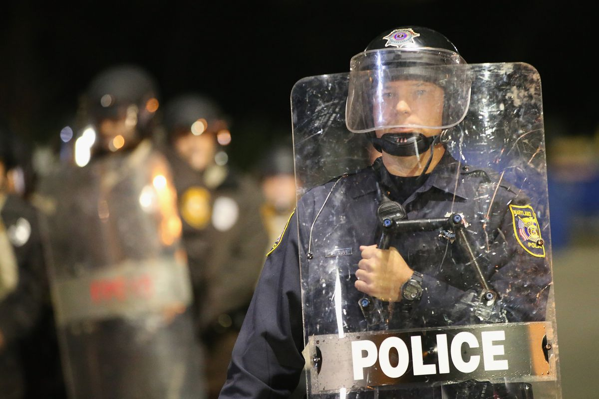 A police officer watches over protesters in Ferguson, Missouri, on October 22.