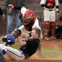 Pleasant Grove's Riley Erickson slides safely into home as American Fork catcher Zac Willis can't hang onto the ball.
