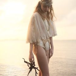Eveliina Vintage Christian Dior bed shawl ($295) and lace garter ($195)