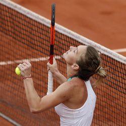 Romania's Simona Halep celebrates winning her semifinal match against Karolina Pliskova of the Czech Republic in three sets 6-4, 3-6, 6-3, at the French Open tennis tournament at the Roland Garros stadium, in Paris, France. Thursday, June 8, 2017.