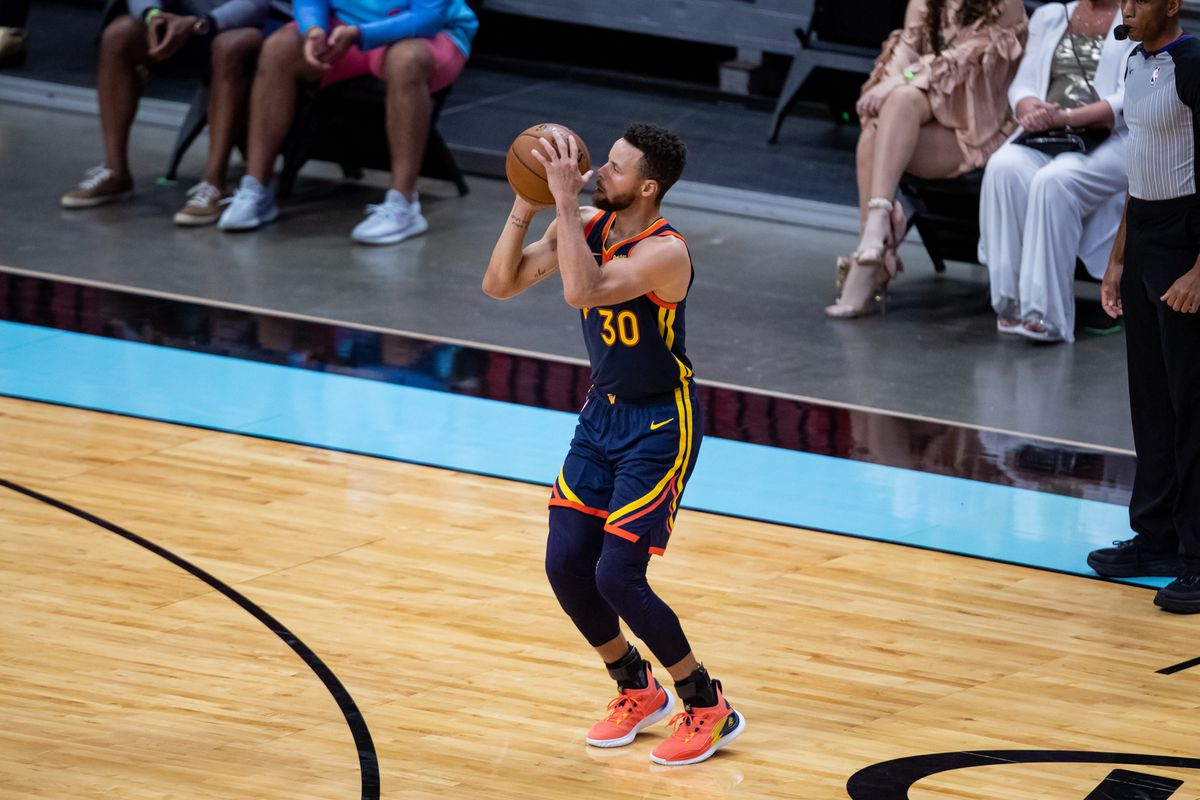 Golden State Warriors guard Stephen Curry attempts a three-point shot during the fourth quarter of a game against the Miami Heat at American Airlines Arena.
