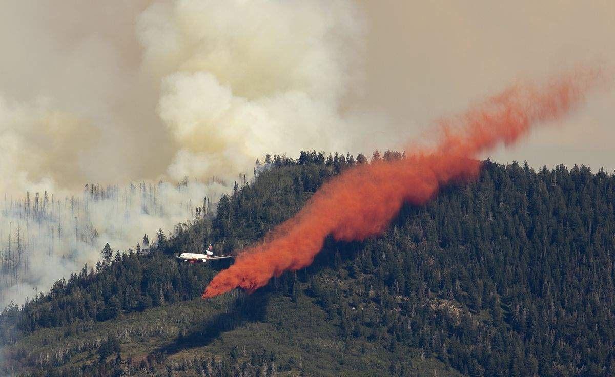 An air tanker drops retardant on the Parley's Canyon fire west of Park City on Saturday, Aug. 14, 2021.