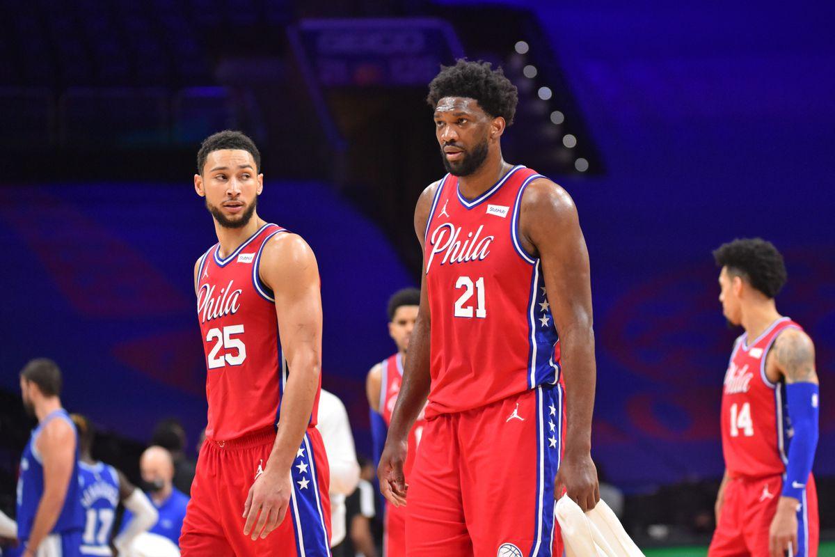 Ben Simmons #25 of the Philadelphia 76ers and Joel Embiid #21 of the Philadelphia 76ers talk during a game against the Los Angeles Lakers on January 27, 2021 at Wells Fargo Center in Philadelphia, Pennsylvania.