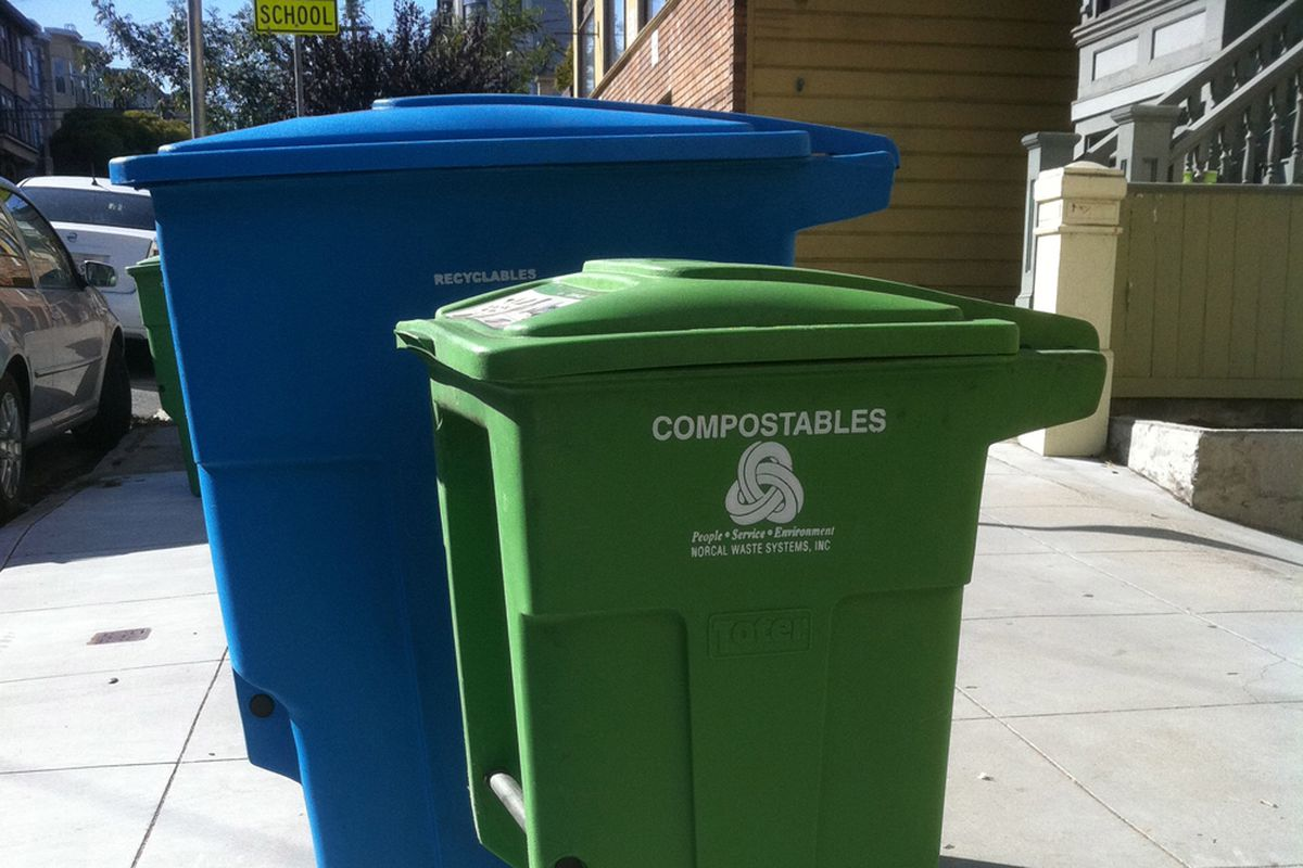 """Big blue recycling or trash cart, smaller green cart that says """"Compostables"""""""