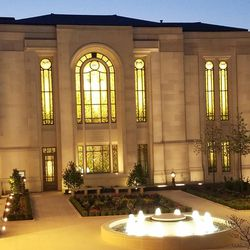 A view of the Paris France Temple at night from the side of the courtyard.