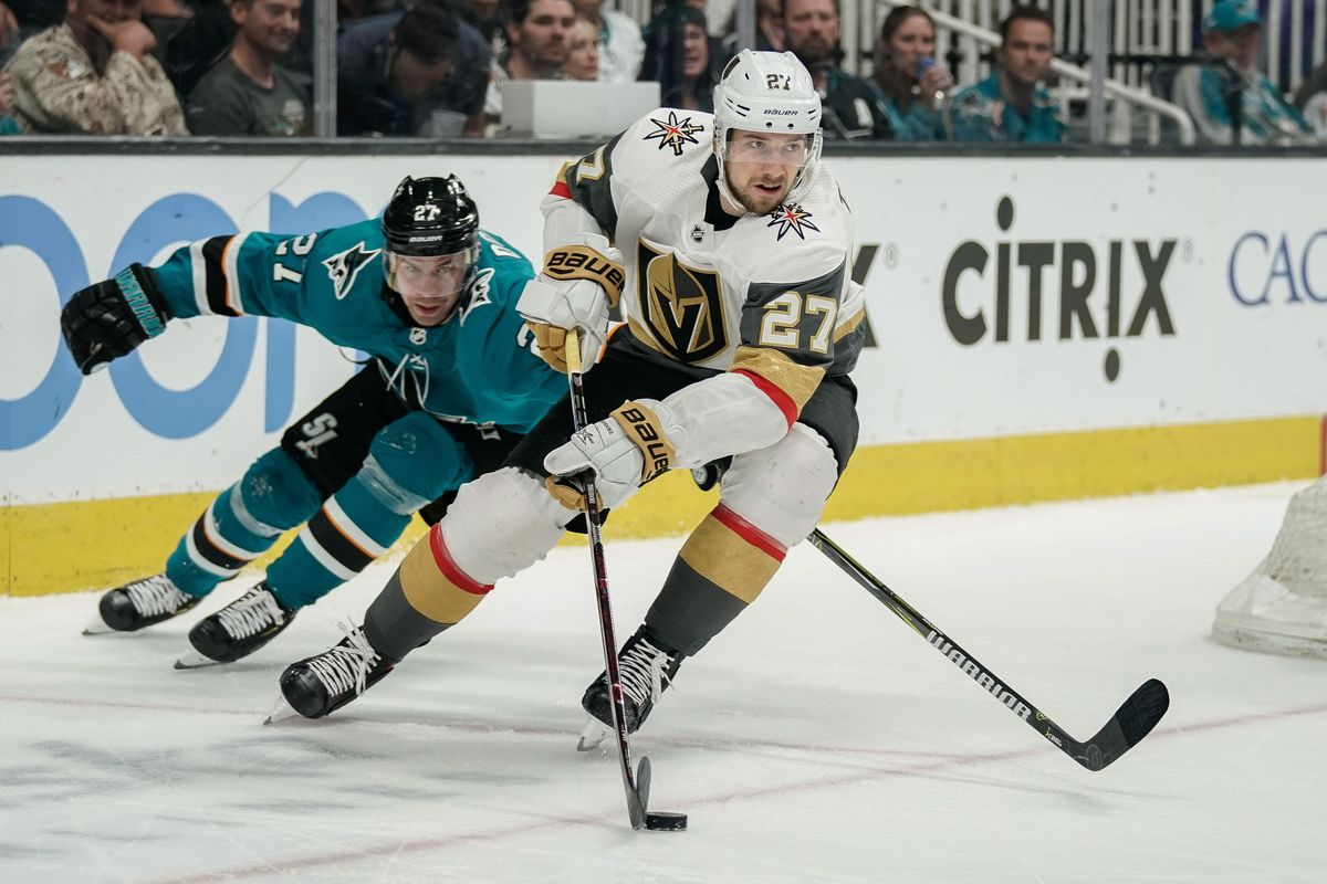 Mar 30, 2019; San Jose, CA, USA; San Jose Sharks right wing Joonas Donskoi (27) and Vegas Golden Knights defenseman Shea Theodore (27) fight for control of the puck during the third period at SAP Center at San Jose