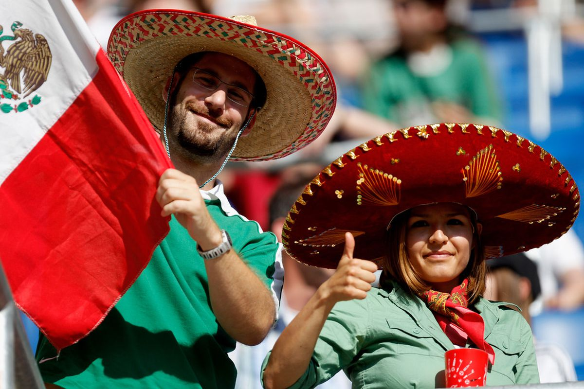 SINSHEIM, GERMANY - JULY 05:  Fans of Mexico celebrates during the FIFA Women's World Cup 2011 Group B match between New Zealand and Mexico at Rhein-Neckar Arena on July 5, 2011 in Sinsheim, Germany.  (Photo by Friedemann Vogel/Getty Images)